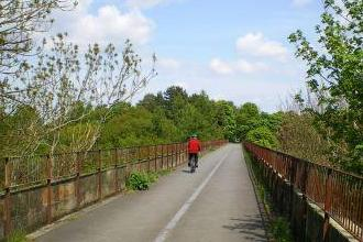 5 nights Cycle C2C Whitehaven - Newcastle across England. Crossing an old railway bridge